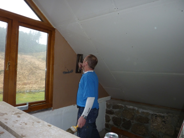 Mark busy with plaster work.