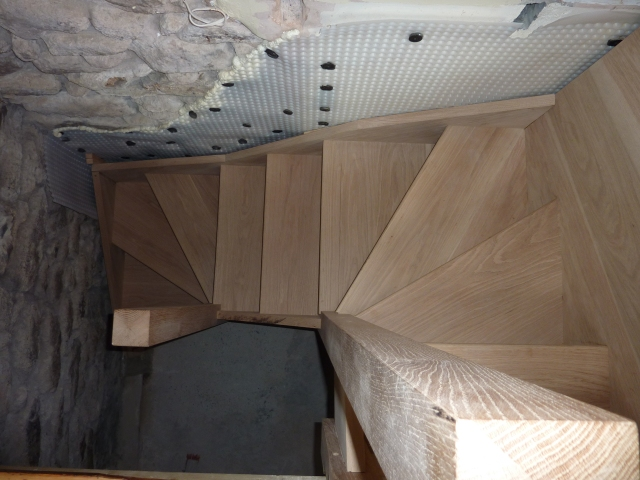 The new stairs.  They are as done as they can be until we finish the downstairs floors and walls.